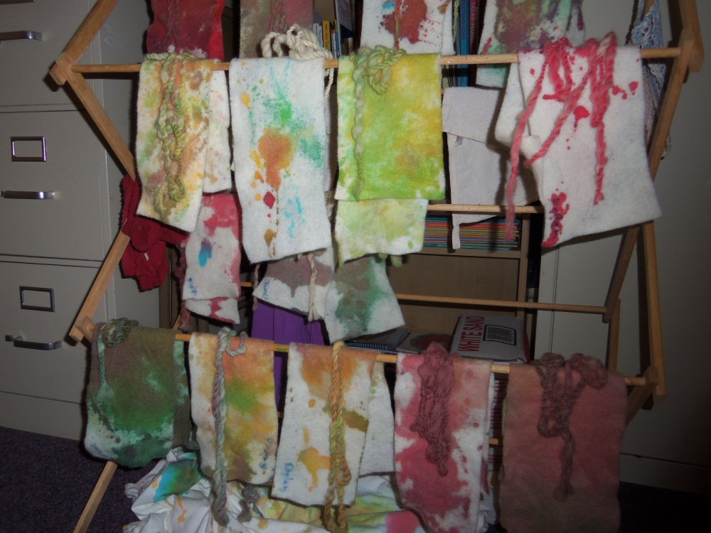strips of felt hanging up to dry